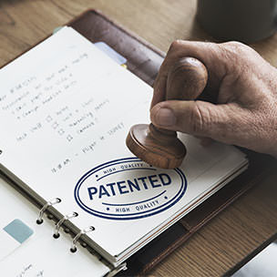 Notebook open to the word Patent